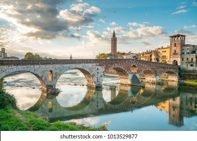 Verona cityscape view on the riverside with historical buildings and towers on sunrise at morning, view of bridge ponte pietra in Verona Italy City.