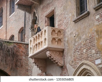 Verona, Italy, 03.25.2018. The girl on the balcony of Juliet's house from Shakespeare's tragedy 'Romeo and Juliet'.