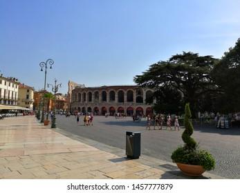 Verona, Italy, 08.27.2018: Piazza Bra (Bra Square) with Arena di Verona (Verona Arena) in the background
