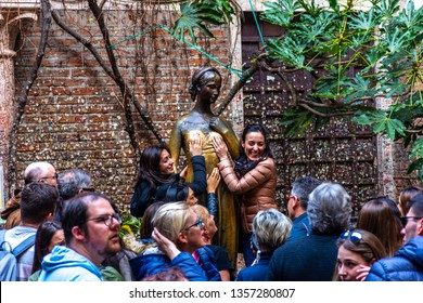 VERONA, ITALY, 19 MARCH 2019 : People visiting the statue of Juliet and Juliet's balcony in Verona Italy