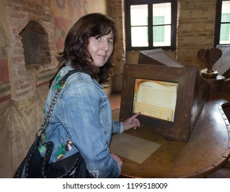 Verona, Italy, 27 September, 2015 : A woman writes a letter to Juliet on the home computer in the house of Juliet in Verona.