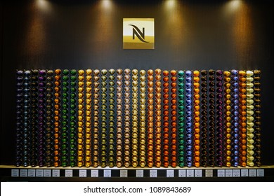 VERONA, ITALY -29 APR 2018- View of a store display of colorful Nespresso single dose coffee capsules.