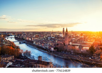 Verona, Italy. Aerial view of famous touristic city Verona in Italy at sunset. Bright sky with illuminated historical buildings