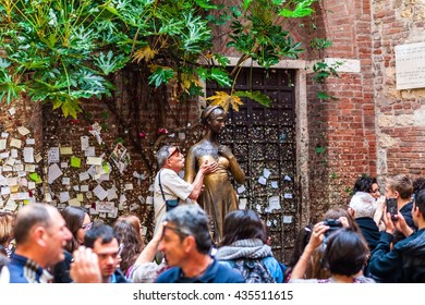 VERONA, ITALY - APRIL 20, 2016: Tourist kisses the Juliet's statue on April 20, 2016 in Verona, Italy.