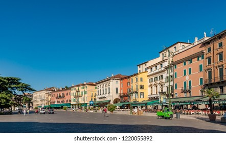 VERONA, ITALY - AUG 4, 2009: people enjoy walking at Piazza Bra in Verona. This place was in roman times a meadow , the Pratum in front of the arena di Verona.
