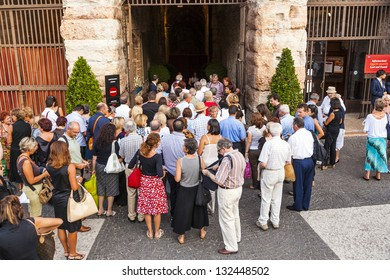 VERONA, ITALY  - AUG 4: visitors wait outside the arena di verona for entrance in the opera on  Aug 4,2009 in Verona, Italy.  The Arena was built by the Romans in the 1st century AD.