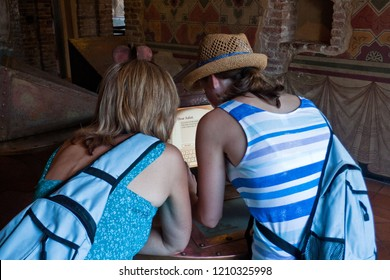 Verona, Italy - August 18, 2012: Tourists writing a letter in Juliet´s house in Verona Italy