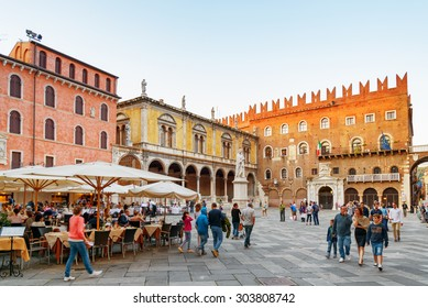 VERONA, ITALY - AUGUST 24, 2014: Street cafes on Piazza delle Erbe (Market square) in Verona, Italy. Verona is a popular tourist destination of Europe.