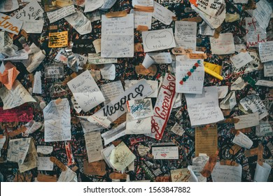 Verona, Italy - August 6, 2019: Love notes stuck on the walls of the Casa di Giulietta