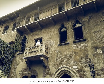 VERONA, ITALY - CIRCA JULY 2016: Vintage desaturated House of Juliet Capulet (Giulietta Capuleti) with balcony made famous by William Shakespeare love tragedy Romeo and Juliet