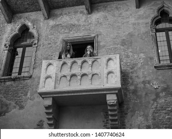 VERONA, ITALY - CIRCA MARCH 2019: House of Juliet Capulet (Giulietta Capuleti) with balcony made famous by William Shakespeare love tragedy Romeo and Juliet in black and white
