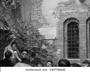 VERONA, ITALY - CIRCA MARCH 2019: Statue of Juliet Capulet (Giulietta Capuleti) made famous by William Shakespeare love tragedy Romeo and Juliet in black and white