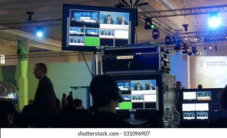 VERONA, ITALY - CIRCA NOVEMBER 2016:  technicians at work in a control room in a conference center.