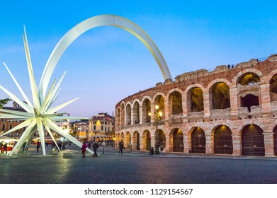 Verona, Italy - December 6, 2013: Brà square,  view of the Arena with a  Christmas comet
