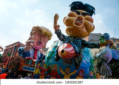 Verona, Italy - February 09, 2018: A satirical paper-pulp figures on a carnival car dedicated to Kim Jong-un and Donald Trump.
