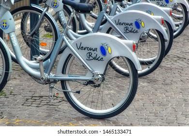 VERONA, ITALY, January 05 2018: Rental Verona Bikes at docking station in downtown Verona, Italy.