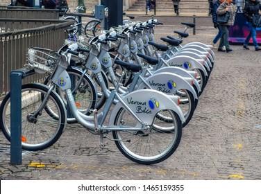 VERONA, ITALY, January 05 2018: Rental Verona Bikes lined up at docking station in downtown Verona, Italy.