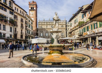 VERONA, ITALY - JANUARY 07, 2018: View of beautiful Market's square (Piazza delle Erbe) with Madonna Verona fountain - old Roman forum, the square hosts a busy and picturesque market.
