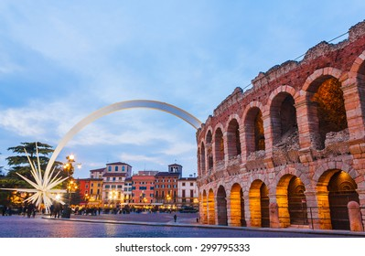 VERONA, ITALY, JANUARY 25, 2015: At arena wall during sunset, is assembled a comet, designed by architect and designer Rinaldo Olivieri: 70 meters high, weighing 78 tons at Piazza Bra, Verona, Italy
