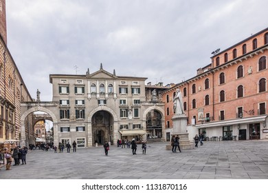 VERONA, ITALY - JANUARY 7, 2018: View of Piazza dei Signori also known as Piazza Dante - square located in center of Verona with statue of Dante in middle of square. Square was founded in middle Ages.