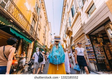 Verona, Italy - July 4, 2018 girl with a backpack on the streets of the city.