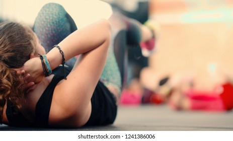 Verona, Italy - June 10, 2018: Beautiful girl athlete engaged in exercises on work abdominal.