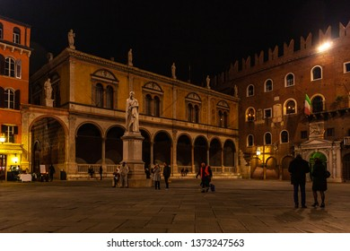 Verona, Italy – March 2019.  Piazza dei Signori, Surrounded by notable buildings, this public square features a statue of Dante Alighieri & cafes. Verona, Italy