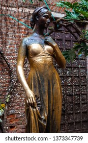 Verona, Italy – March 2019. Statue of Juliet in garden of Gothic-style 1300s house and museum, with a stone balcony, inspired Romeo and Juliet is a tragedy written by William Shakespeare, Verona