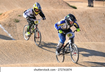 """VERONA, ITALY - MARCH 28: Unidentified child BMX rider on March 28, 2015 in Verona, Italy. This competition included young riders from many European countries at the """"BMX Olympic Arena"""" in Verona."""
