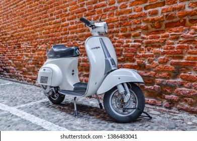VERONA, ITALY - MAY 1, 2019: Old Vespa parked on old street in Verona, Italy