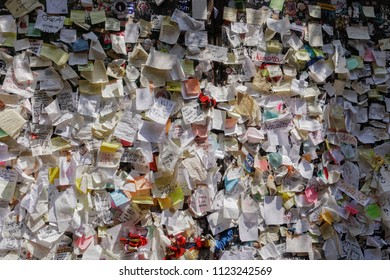 Verona, Italy - May 11 2018: Casa di Giulieta letters wall. Juliets house courtyard paper notes with attached love messages and locks.