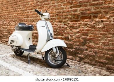 VERONA, ITALY - MAY 16, 2014: Old Vespa parked on old street in Verona, Italy.