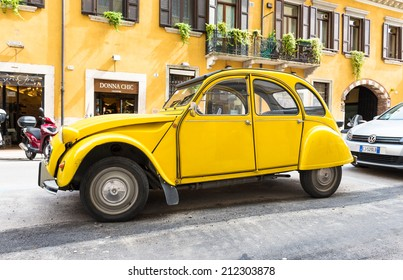VERONA, ITALY - MAY 16, 2014: Old Citroen 2CV parked on the street of Verona, Italy