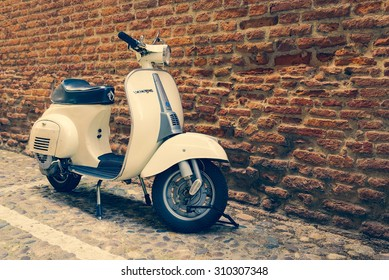 VERONA, ITALY - MAY 16, 2014: Old Vespa parked on old street in Verona, Italy.