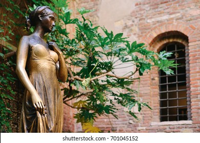 VERONA, ITALY - MAY, 2017: Patio and statue Juliet, Verona, Italy. Very popular tourist place.