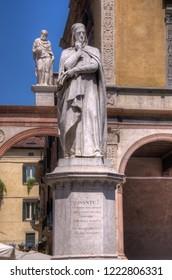 "Verona, Italy - May 21, 2017: Statue of Dante Alighieri in Piazza Dante, Verona, Italy.  Dante is known for his work ""Divine Comedy""."
