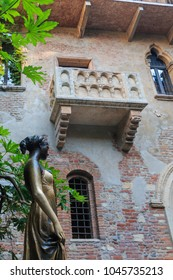 Verona, Italy - May 26, 2017: Statue and balcony at Juliet's house are a major landmark and tourist attraction in Verona, Italy