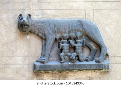 VERONA, ITALY - MAY 27, 2017: Replica of Capitoline Wolf (Lupa Capitolina) depicting a she-wolf suckling twin human infants, Romulus and Remus, the legendary founders of Rome, bass-relief in Verona.