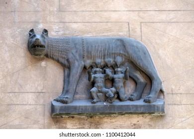 VERONA, ITALY - MAY 27, 2017: Replica of Capitoline Wolf (Lupa Capitolina) depicting a she-wolf suckling twin human infants, Romulus and Remus, the legendary founders of Rome, bass relief in Verona.