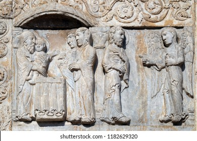 VERONA, ITALY - MAY 27, 2017: Presentation of Jesus in the Temple and angel appeared to Joseph in a dream to tell him to flee to Egypt, medieval relief on the facade of Basilica of San Zeno in Verona.