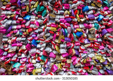 VERONA, ITALY - MAY 3 : Cropped shot of gate filled with colourful padlocks in Juliet's House. MAY 3, 2015 in Verona.