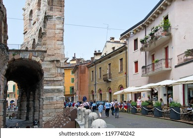 VERONA, ITALY - May 6, 2018: Tourists next Verona Arena in the suny day.  Verona Arena is well-preserved ancient Roman amphitheater and the main tourist attraction in Verona.