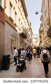VERONA, ITALY - May 6, 2018: Tourists walking in the street in the sunny day.  Pedestrian precinct in Verona packed with tourists and shoppers.