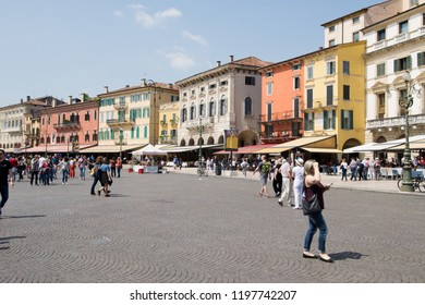 VERONA, ITALY - May 6, 2018: Tourists in Piazza Bra in sunny day.  The largest square in Verona is lined with cafes and restaurants from where tourists can admire the beauty of Verona Arena