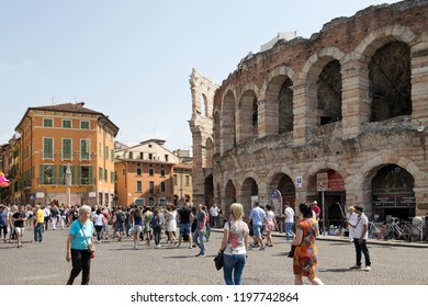 VERONA, ITALY - May 6, 2018: Tourists in front of Verona Arena in the sunny day. Well-preserved ancient Roman amphitheater which is used for opera performances now is Verona's landmark