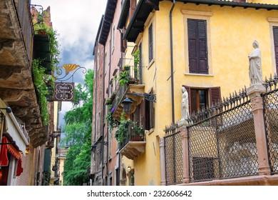 VERONA, ITALY - MAY 7, 2014: Houses on the street Via Arche Scaligere in Verona, Italy