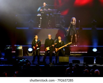 Verona, Italy - October 14, 2017: Live Concert of Umberto Tozzi an Italian singer  on stage with guitarist and bass player at Verona Arena