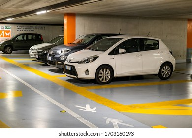 Verona, Italy - October 21, 2019: Modern cars parked inside closed underground parking lot.