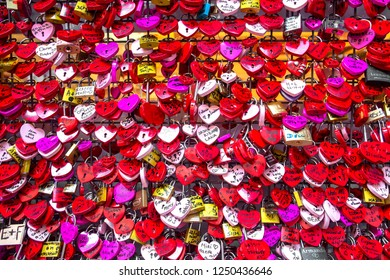 Verona, Italy - October 23, 2018: Juliet's House In Verona, Italy. Many colourful love padlocks at the wall of Juliet's house, Verona, Italy. romantic pattern