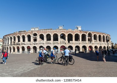 Verona, Italy - October 5, 2018: Tourists by the ancient arena at Piazza Bra in the city of Verona in Italy